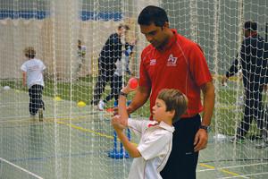 Ali guiding student on batting technique